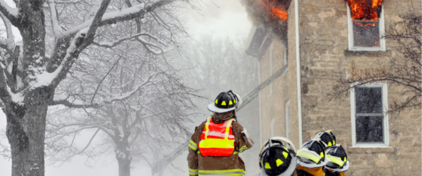 Graphic of firefighters fighting a fire in winter