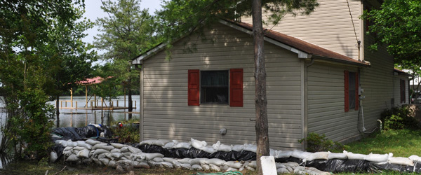 Graphic of a home surrounded with sandbags